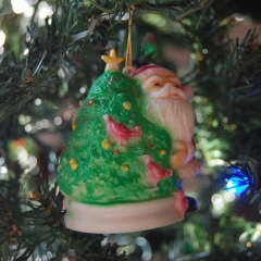 This one was on our tree when I was growing up - always near the bottom because kids and cats couldn't hurt it.