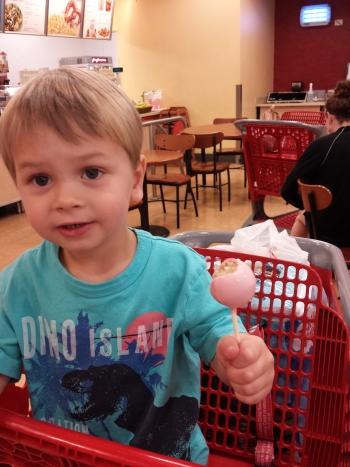 Enjoying a cake pop at Target